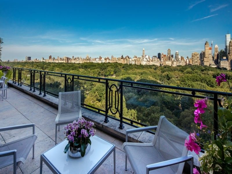 elegant duplex penthouse featuring its own spiral staircase and glass an elite condominium community the twolevel penthouse is
